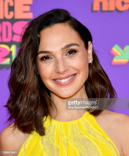 In this image released on March 13, Gal Gadot attends Nickelodeon's Kids' Choice Awards at Barker Hangar on March 13, 2021 in Santa Monica,...