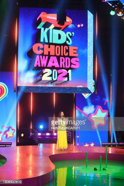 In this image released on March 13, Gal Gadot speaks onstage during Nickelodeon's Kids' Choice Awards at Barker Hangar on March 13, 2021 in Santa...
