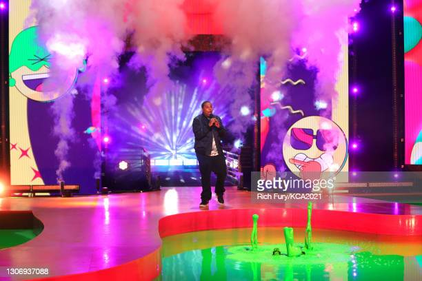 In this image released on March 13, Host Kenan Thompson speaks onstage during Nickelodeon's Kids' Choice Awards at Barker Hangar on March 13, 2021 in...