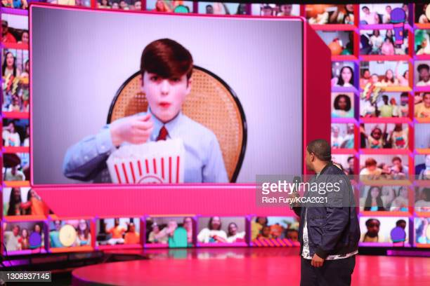 In this image released on March 13, Iain Armitage, winner of Favorite Male TV Star for 'Young Sheldon' , and Host Kenan Thompson speak onstage during...