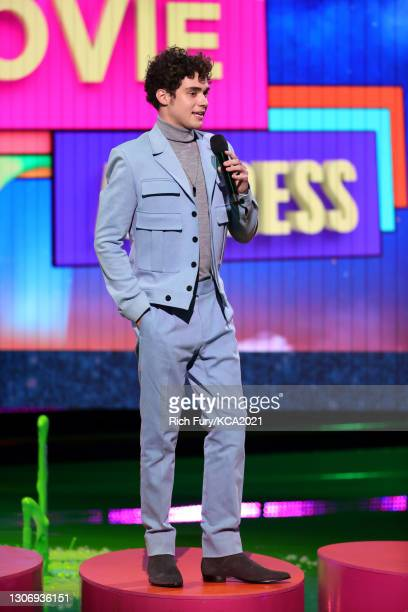 In this image released on March 13, Joshua Bassett speaks onstage during Nickelodeon's Kids' Choice Awards at Barker Hangar on March 13, 2021 in...