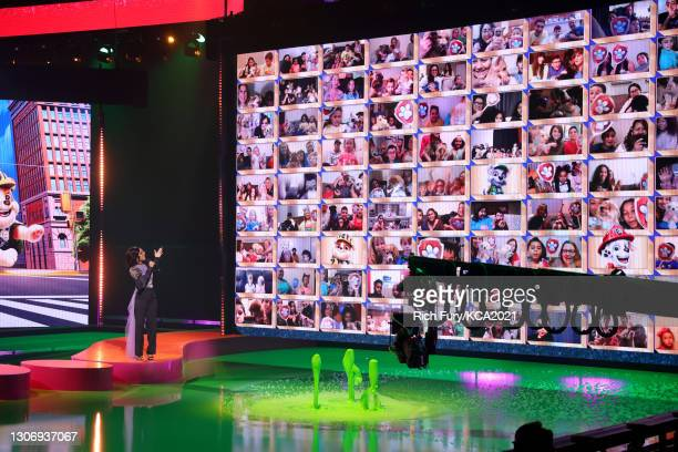 In this image released on March 13, Marsai Martin speaks onstage during Nickelodeon's Kids' Choice Awards at Barker Hangar on March 13, 2021 in Santa...