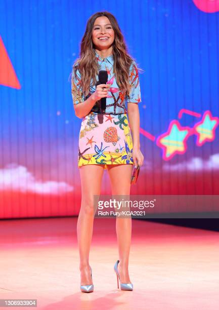 In this image released on March 13, Miranda Cosgrove speaks onstage during Nickelodeon's Kids' Choice Awards at Barker Hangar on March 13, 2021 in...
