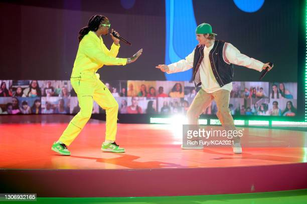 In this image released on March 13, Quavo and Justin Bieber perform onstage during Nickelodeon's Kids' Choice Awards at Barker Hangar on March 13,...