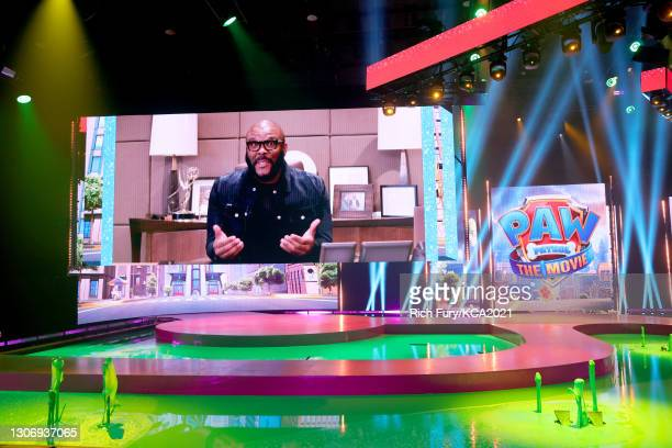 In this image released on March 13, Tyler Perry is seen onscreen during Nickelodeon's Kids' Choice Awards at Barker Hangar on March 13, 2021 in Santa...