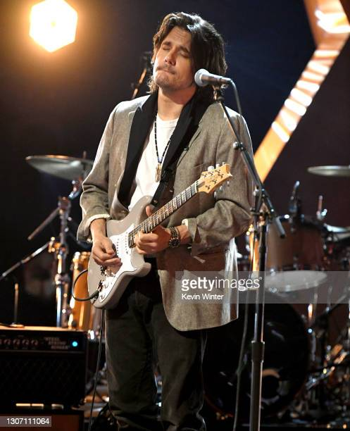 In this image released on March 14, John Mayer performs onstage during the 63rd Annual GRAMMY Awards at Los Angeles Convention Center in Los Angeles,...