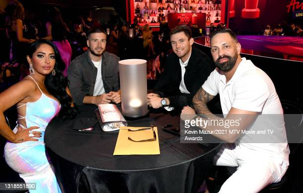 In this image released on May 17, Angelina Pivarnick, Vinny Guadagnino, a guest, and Christopher Larangeira pose during the 2021 MTV Movie & TV...