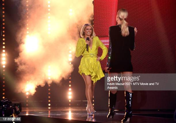 In this image released on May 17, host Nikki Glaser welcomes Paris Hilton onstage during the 2021 MTV Movie & TV Awards: UNSCRIPTED in Los Angeles,...