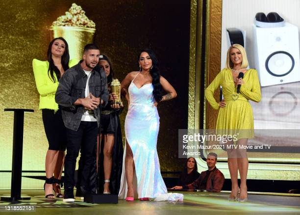 "In this image released on May 17, Jenni ""JWOWW"" Farley, Vinny Guadagnino, Nicole ""Snooki"" Polizzi, and Angelina Pivarnick accept the Reality Royalty..."