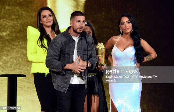 """In this image released on May 17, Jenni """"JWOWW"""" Farley, Vinny Guadagnino, Nicole """"Snooki"""" Polizzi, and Angelina Pivarnick accept the Reality Royalty..."""