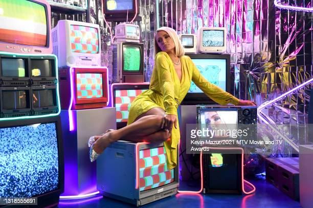 In this image released on May 17, Paris Hilton poses backstage during the 2021 MTV Movie & TV Awards: UNSCRIPTED in Los Angeles, California.