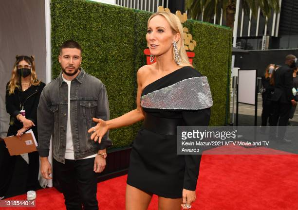 In this image released on May 17, Vinny Guadagnino and host Nikki Glaser attend the 2021 MTV Movie & TV Awards: UNSCRIPTED in Los Angeles, California.
