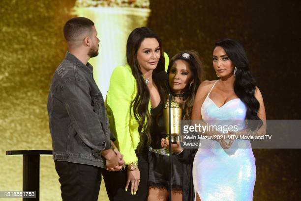 """In this image released on May 17, Vinny Guadagnino, Jenni """"JWOWW"""" Farley, Nicole """"Snooki"""" Polizzi, and Angelina Pivarnick accept the Reality Royalty..."""