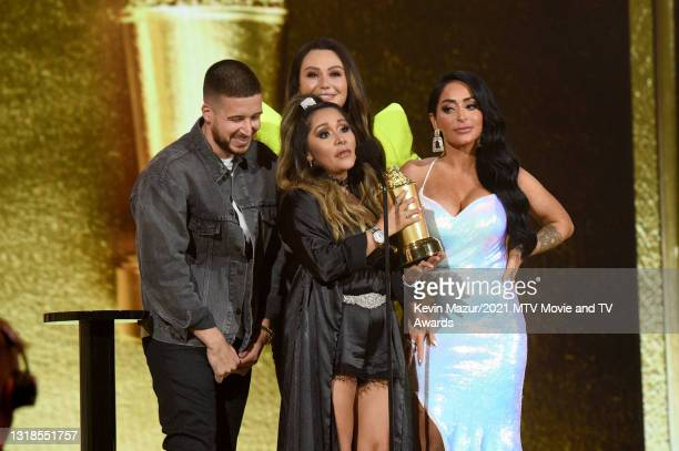 """In this image released on May 17, Vinny Guadagnino, Nicole """"Snooki"""" Polizzi, Jenni """"JWOWW"""" Farley, and Angelina Pivarnick accept the Reality Royalty..."""
