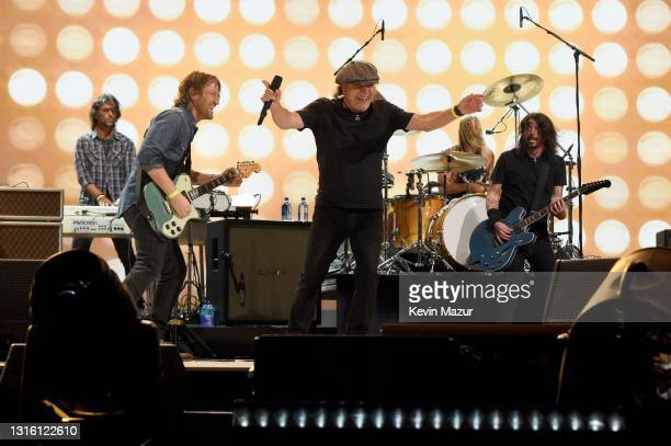 In this image released on May 2, Brian Johnson of music group AC/DC performs onstage with Chris Shiflett, Rami Jaffee, Dave Grohl, and Taylor Hawkins...