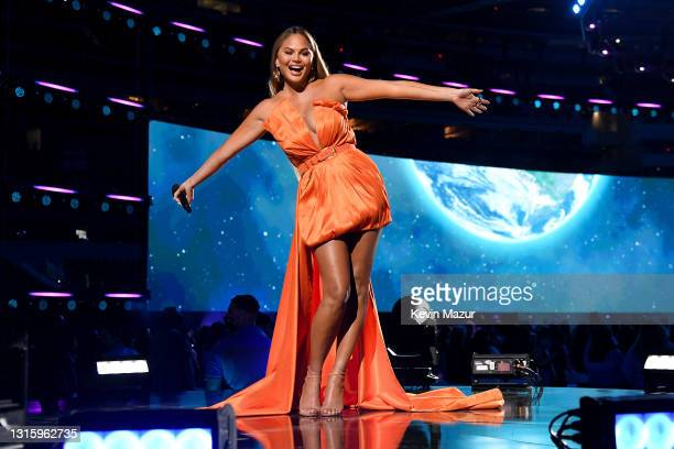 In this image released on May 2, Chrissy Teigen speaks onstage at Global Citizen VAX LIVE: The Concert To Reunite The World at SoFi Stadium in...