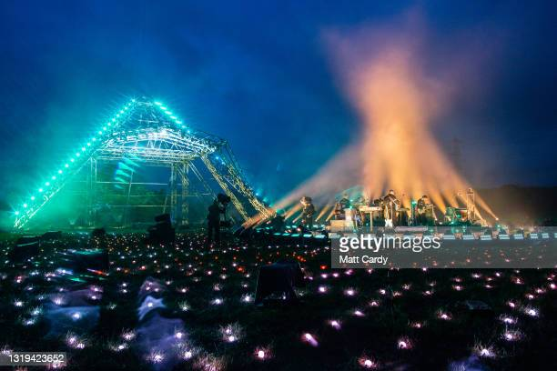 """In this image released on May 22nd, Coldplay performs in front of the main Pyramid Stage as part of the Glastonbury Festival Global Livestream """"Live..."""