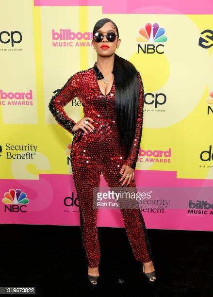 In this image released on May 23, H.E.R. Poses backstage for the 2021 Billboard Music Awards, broadcast on May 23, 2021 at Microsoft Theater in Los...