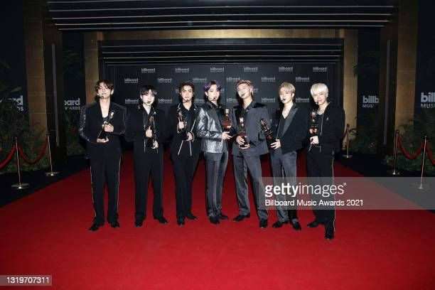 In this image released on May 23, V, Suga, Jin, Jungkook, RM, Jimin, and J-Hope of BTS, winners of the Top Selling Song Award for 'Dynamite,' pose...