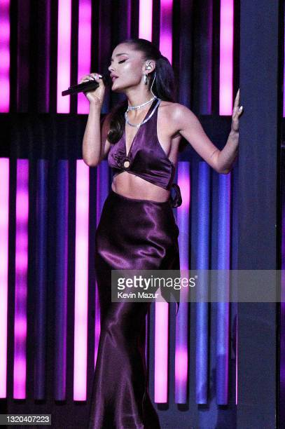 In this image released on May 27, Ariana Grande performs onstage at the 2021 iHeartRadio Music Awards at The Dolby Theatre in Los Angeles,...