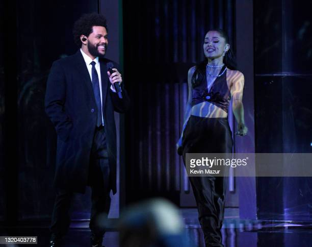 In this image released on May 27, The Weeknd and Ariana Grande perform onstage at the 2021 iHeartRadio Music Awards at The Dolby Theatre in Los...
