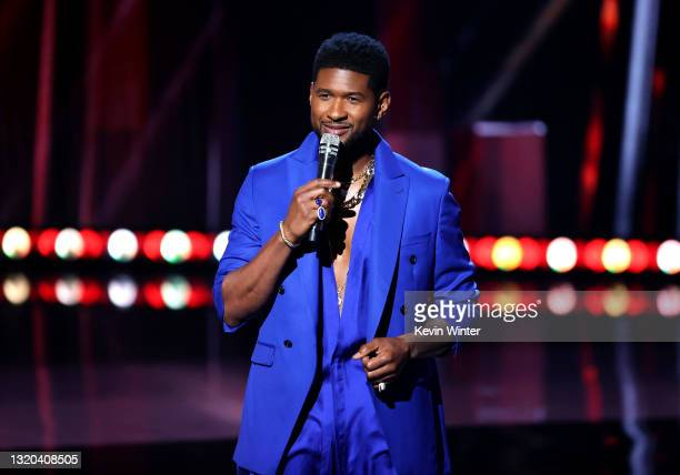 In this image released on May 27, Usher speaks onstage at the 2021 iHeartRadio Music Awards at The Dolby Theatre in Los Angeles, California, which...