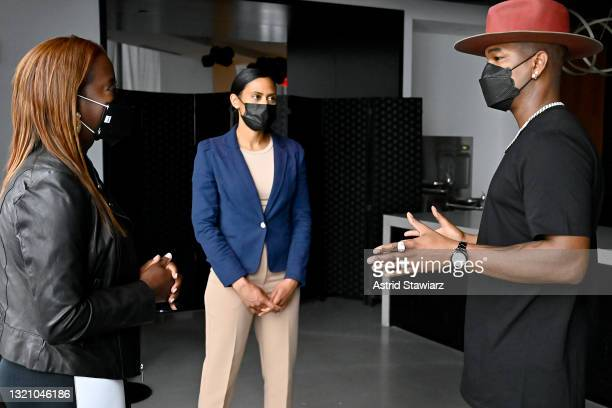 In this image released on May 31 Nurse Larissa Niewdach-Ebron and Sandra Lindsay speak to NE-YO during Northwell Health's 2021 Side By Side: A...