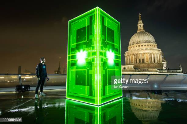 In this image released on November 10th Xbox launches the Xbox Series X in the UK with a spectacular holographic installation as a gamer looks on at...