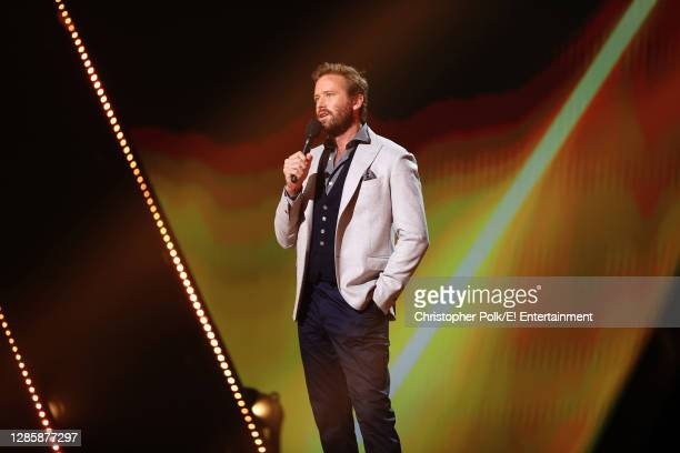 In this image released on November 15, Armie Hammer speaks onstage for the 2020 E! People's Choice Awards held at the Barker Hangar in Santa Monica,...