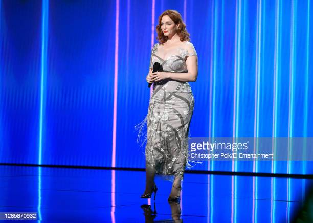 In this image released on November 15, Christina Hendricks speaks onstage for the 2020 E! People's Choice Awards held at the Barker Hangar in Santa...