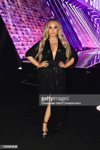 In this image released on November 15, Demi Lovato poses onstage for the 2020 E! People's Choice Awards held at the Barker Hangar in Santa Monica,...