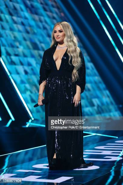 In this image released on November 15, Demi Lovato speaks onstage for the 2020 E! People's Choice Awards held at the Barker Hangar in Santa Monica,...