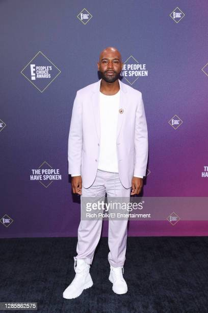 In this image released on November 15, Karamo Brown arrives at the 2020 E! People's Choice Awards held at the Barker Hangar in Santa Monica,...
