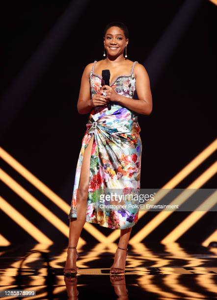 In this image released on November 15, Tiffany Haddish speaks onstage for the 2020 E! People's Choice Awards held at the Barker Hangar in Santa...