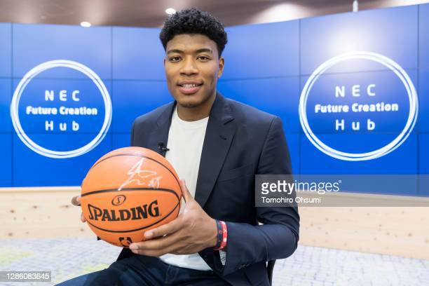 In this image released on November 17 Rui Hachimura of the Washington Wizards poses for a photograph as he tours the NEC Corporation headquarters on...