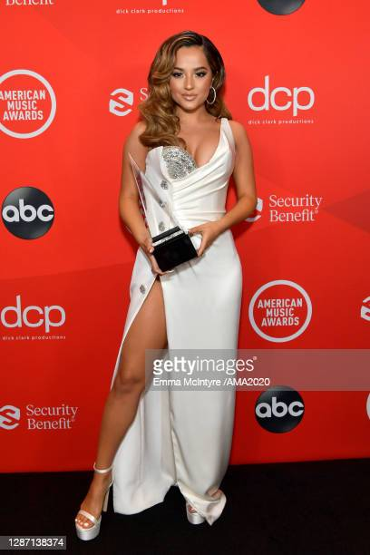In this image released on November 22, Becky G poses with the award for Favorite Latin Female Artist at the 2020 American Music Awards at Microsoft...
