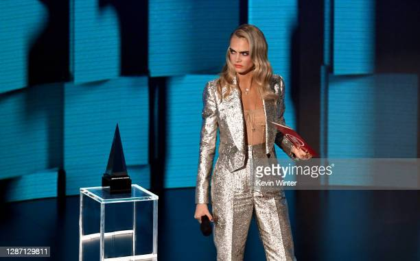 In this image released on November 22, Cara Delevingne speaks onstage for the 2020 American Music Awards at Microsoft Theater on November 22, 2020 in...