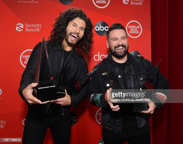 In this image released on November 22 Dan Smyers and Shay Mooney of Dan Shay pose with the awards for Favorite Country Song Favorite Country Duo or...