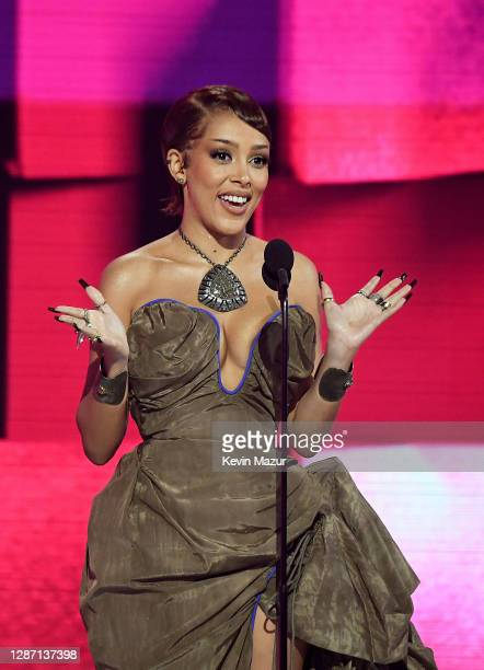 In this image released on November 22, Doja Cat accepts the award for Favorite Soul/R&B Female Artist onstage for the 2020 American Music Awards at...