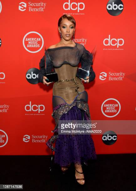 In this image released on November 22 Doja Cat poses with the Favorite Female Soul/RB Artist and New Artist of the Year awards backstage during the...