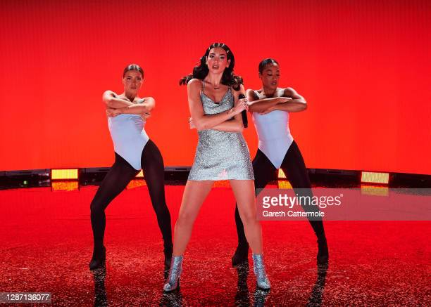 In this image released on November 22, Dua Lipa performs onstage for the 2020 American Music Awards, broadcast on November 22, 2020 London, England.