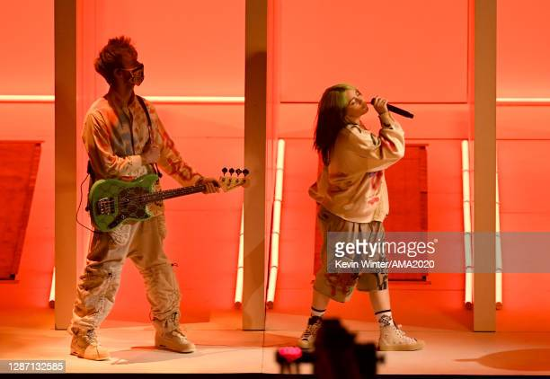 In this image released on November 22, Finneas and Billie Eilish perform onstage for the 2020 American Music Awards at Microsoft Theater on November...
