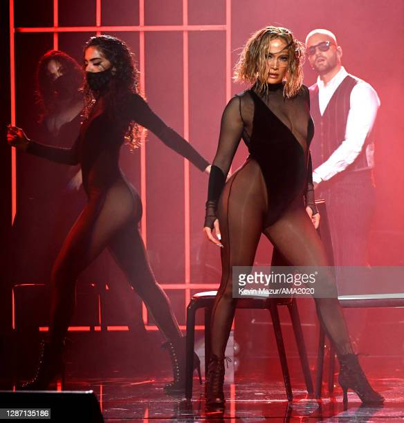 In this image released on November 22, Jennifer Lopez and Maluma perform onstage for the 2020 American Music Awards at Microsoft Theater on November...