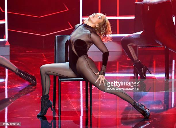 In this image released on November 22, Jennifer Lopez performs onstage for the 2020 American Music Awards at Microsoft Theater on November 22, 2020...