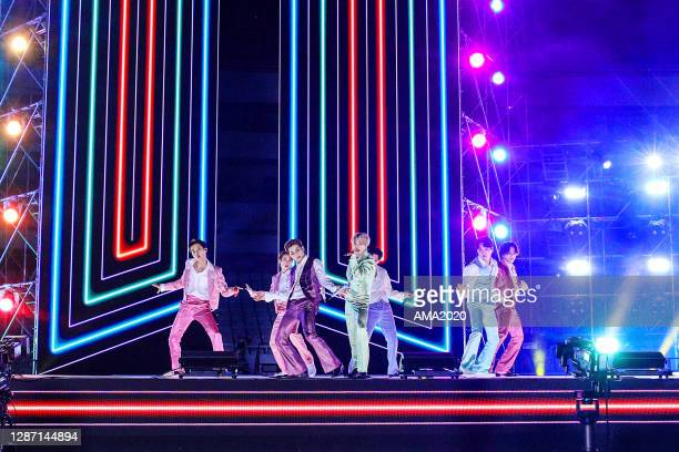 In this image released on November 22, J-Hope, Jin, RM, Jimin, V, Suga, and Jungkook of BTS perform onstage for the 2020 American Music Awards on...