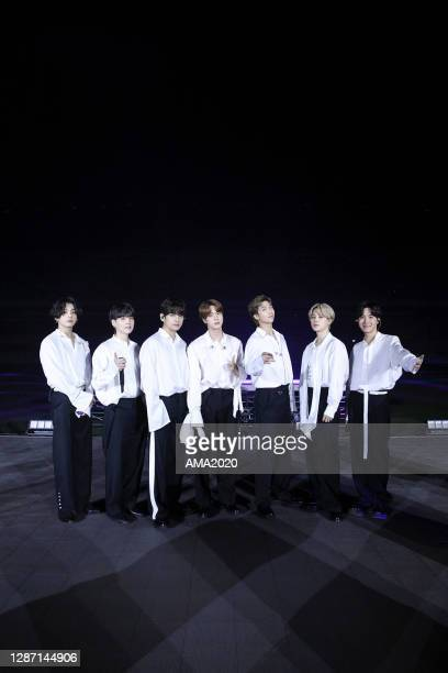 In this image released on November 22, Jungkook, Suga, V, Jin, RM, Jimin, and J-Hope of BTS perform onstage for the 2020 American Music Awards on...