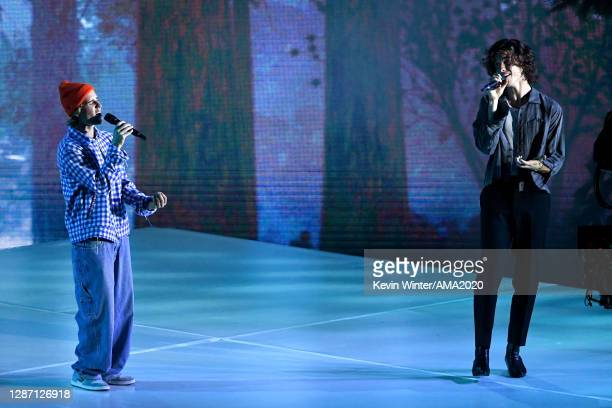 In this image released on November 22, Justin Bieber and Shawn Mendes perform onstage for the 2020 American Music Awards at Microsoft Theater on...