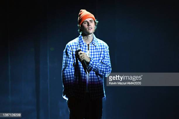 In this image released on November 22, Justin Bieber performs onstage for the 2020 American Music Awards at Microsoft Theater on November 22, 2020 in...