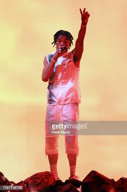 In this image released on November 22 Lil Baby performs onstage for the 2020 American Music Awards at Microsoft Theater on November 22 2020 in Los...