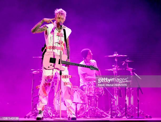 In this image released on November 22, Machine Gun Kelly and Travis Barker perform onstage for the 2020 American Music Awards at Microsoft Theater on...